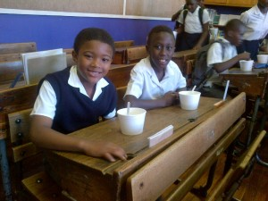 Breakfast time between classmates at Ysterplaat Primary in Cape Town