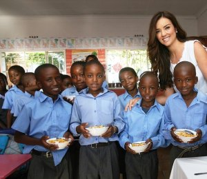Cindy Nell-Roberts shares breakfast with learners at Ikwezi Primary School in Soweto