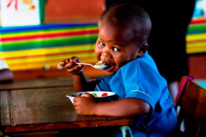 Swelihle Masuku from Gugulethu Primary in Kwamashu, KZN enjoying his first breakfast for the year Low res