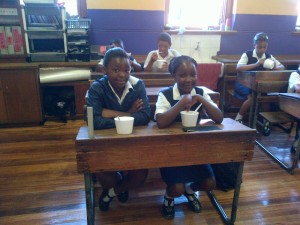 Ysterplaat Primary School learners in Cape Town sit down to enjoy breakfast before the learning begins